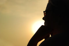 Relaxed Silhouette of Woman by Sunset Royalty Free Stock Photo