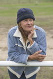 Relaxed single woman warm jacket and bonnet outdoor Stock Image