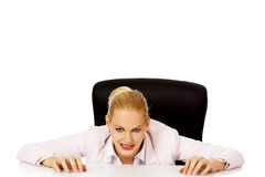 Relaxed smile business woman lying on the desk.  Stock Photos