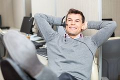 Relaxed Smiling Customer Service Representative Stock Photography