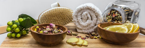 Relaxed SPA setting with herbal tea and brush Royalty Free Stock Images