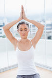Relaxed sporty brunette sitting in yoga posture Royalty Free Stock Photography