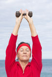 Relaxed sporty mature woman exercising Royalty Free Stock Photo