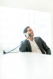 Relaxed successful businessman talking on a phone Royalty Free Stock Photo