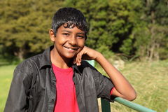 Relaxed teenage boy in bright countryside sunshine. Teenage boy, 13, with big smile relaxing in bright sunshine in the countryside Royalty Free Stock Photos