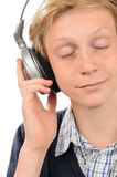 Relaxed teenage boy enjoying music Stock Images