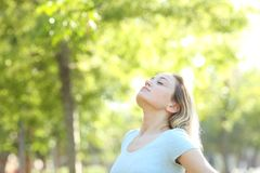 Free Relaxed Teenage Girl Breathing Fresh Air In A Park Stock Photography - 151482142