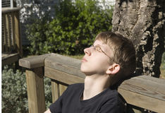 Relaxed teenager outdoors. Enjoying the sun - adobe RGB Stock Photography