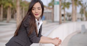 Relaxed thoughtful young woman leaning on railings stock video