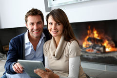 Relaxed time by fireplace Royalty Free Stock Photography
