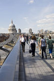 Relaxed tourists crossing millenium bridge Stock Photos
