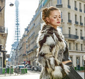 Relaxed trendy woman in fur coat in Paris, France Stock Photography