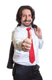 Relaxed turkish businessman with suit showing thumb Stock Images