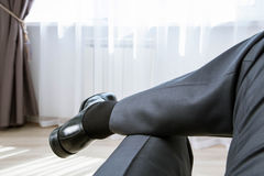 Relaxed unrecognizable businessman in informal atmosphere Stock Images