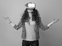 Relaxed woman against back in virtual reality headset Stock Photos