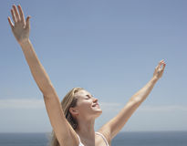 Relaxed Woman With Arms Outstretched Outdoors Royalty Free Stock Image
