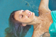 Relaxed woman on back in swimming Royalty Free Stock Images