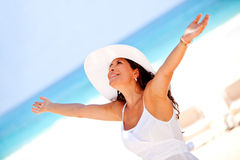 Relaxed woman at the beach Royalty Free Stock Photo