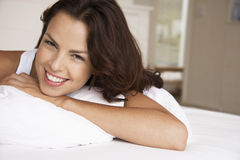 Relaxed Woman In Bed Smiling Royalty Free Stock Images