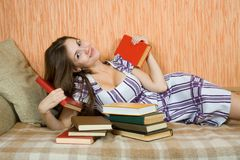 Relaxed woman with books Stock Photography