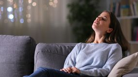 Relaxed woman breathing fresh air at home in the night stock video