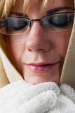 Relaxed woman with cape and gloves Stock Photos