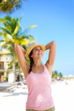 Relaxed woman on caribbean summer vacation Stock Images
