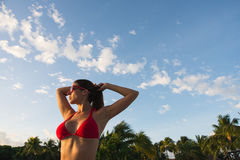 Relaxed woman on caribbean summer vacation at tropical resort stock image