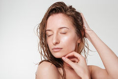 Relaxed woman with closed eyes Royalty Free Stock Photos