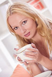 Relaxed woman with cup tea Stock Image