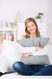 Relaxed Woman With Cushion At Home Royalty Free Stock Photos