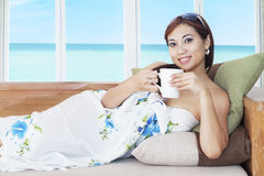 Relaxed woman drinking coffee Royalty Free Stock Photos