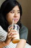 Relaxed woman drinking coffee Stock Photo