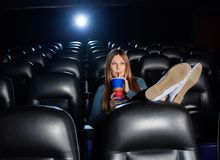 Relaxed Woman Drinking Cola While Watching Movie Stock Photography