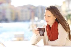 Relaxed woman drinking in a coffee shop royalty free stock photo
