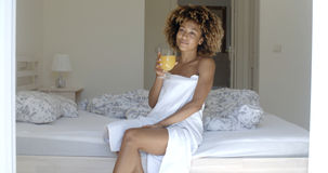 Relaxed Woman Drinking Orange Juice Stock Photos