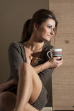 Relaxed woman drinking tea or coffee Royalty Free Stock Image