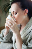 Relaxed woman drinking tea at spa resort Royalty Free Stock Photos