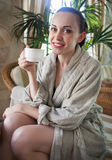 Relaxed woman drinking tea at spa resort Stock Photo