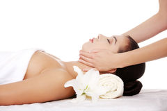 Relaxed woman enjoy receiving face massage. Beautiful young relaxed woman enjoy receiving face massage at spa saloon Royalty Free Stock Image
