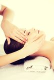Relaxed woman enjoy receiving face massage Royalty Free Stock Image