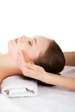 Relaxed woman enjoy receiving face massage. At spa saloon Stock Photos
