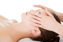 Relaxed woman enjoy receiving face massage Royalty Free Stock Photos