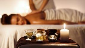 Relaxed woman enjoying aromatherapy massage in luxury spa