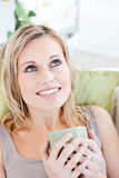 Relaxed woman enjoying her coffee Stock Photo