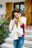 Relaxed woman enjoying hot coffee cup outside on autumn Royalty Free Stock Photos