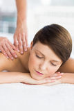 Relaxed woman enjoying massage. Relaxed woman enjoying back massage at spa Stock Photography