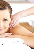 Relaxed woman enjoying a massage in a spa center Stock Photography