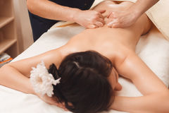 Relaxed woman enjoying massage at spa Stock Photos