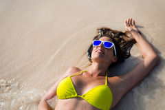 Relaxed woman enjoying summer vacation at the beach Royalty Free Stock Image